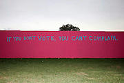 "St. Louis, MO, USA, 20041008: A Grafitti on a wall outside the University says ""If you don't vote you can't complain,"" during the second Presidential Debate held at Washington University in St. Louis.<br />