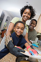 Mother father and son in domestic kitchen, washing dishes