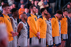 Jan 15, 2018; Morgantown, WV, USA; West Virginia Mountaineers players stand for the National Anthem before their game against the Kansas Jayhawks at WVU Coliseum. Mandatory Credit: Ben Queen-USA TODAY Sports