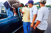 02 AUGUST 2001 - PHOENIX, ARIZONA, USA: Day laborers at the corner of Thomas Rd and 36th Street in Phoenix clamor for work when a pick up truck stops at the corner. Many of the day laborers who look for work on valley street corners are undocumented immigrants. .PHOTO BY JACK KURTZ  NMR