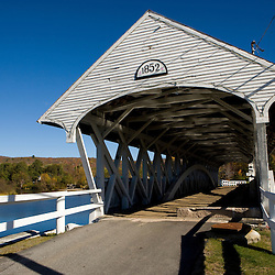 The covered bridge over the Upper Ammonoosuc River in Groveton, New Hampshire.  Wausau Paper Mill.
