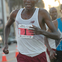 Haron Lagat, 24, who hails from Kenya but currently living in Santa Fe, leads the pack during  the second annual Saint John's Santa Monica 5000 on Sunday, October 21, 2007. He came in first place with a time of 14:04 and won the $1500 plus an additional $300 bonus for finishing under 14:20. Lagat also won last years race but beat last years first place win by 8 seconds...