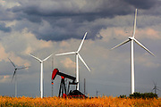 Sweetwater in Texas aims to be the windpower capitol of the world. A pumpjack siphons oil in the foreground. Best known for the annual Rattlesnake Roundup Festival now also host the West Texas Wind Harvest Festival.