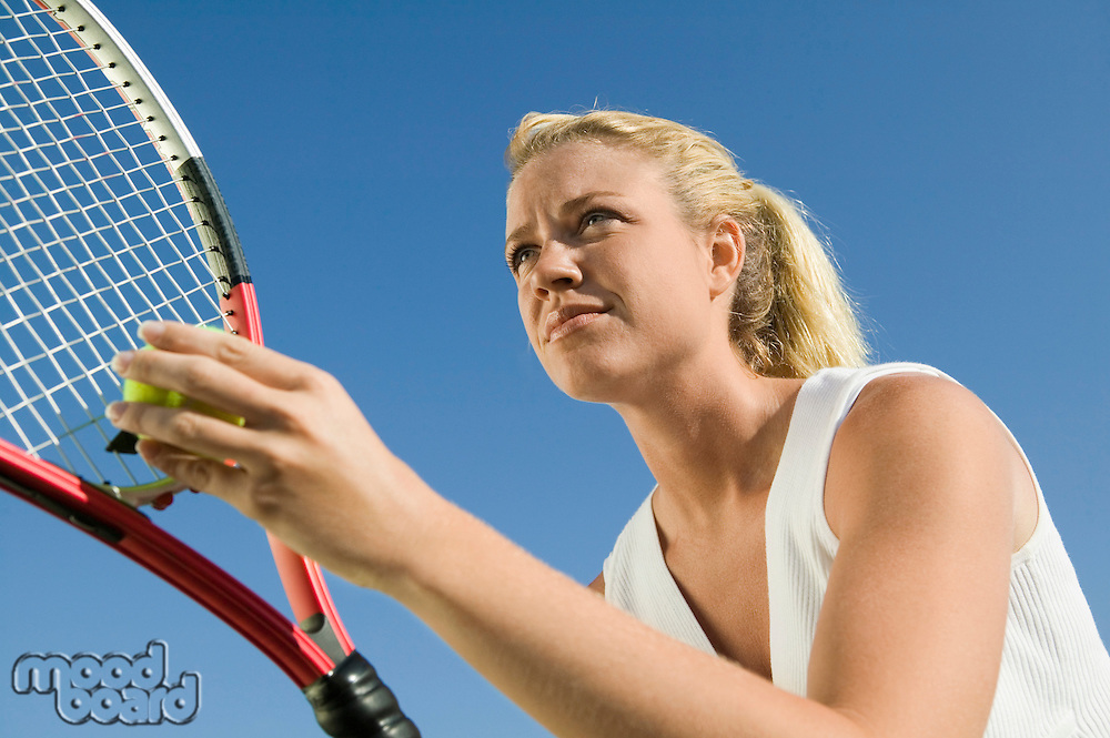 Female Tennis Player Preparing to Serve low angle view close up