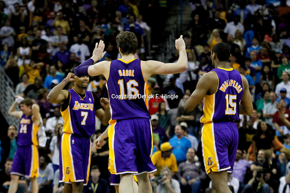 April 9, 2012; New Orleans, LA, USA; Los Angeles Lakers power forward Pau Gasol (16) celebrates with teammate during the fourth quarter of a game against the New Orleans Hornets at the New Orleans Arena. The Lakers defeated the Hornets 93-91. Mandatory Credit: Derick E. Hingle-US PRESSWIRE