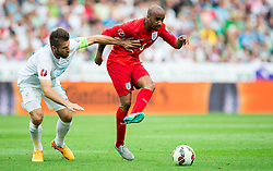 Bostjan Cesar of Slovenia vs Fabian Delph of England during the EURO 2016 Qualifier Group E match between Slovenia and England at SRC Stozice on June 14, 2015 in Ljubljana, Slovenia. Photo by Vid Ponikvar / Sportida