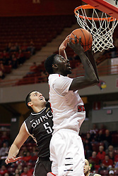 "27 November 2015: Joseph Tagarelli can't write stop the shot by Daouda ""David"" Ndiaye (4). Illinois State Redbirds host the Quincy Hawks at Redbird Arena in Normal Illinois (Photo by Alan Look)"