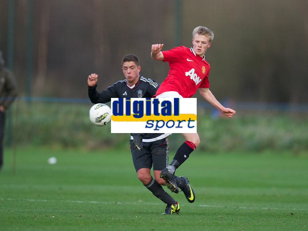 MANCHESTER, ENGLAND - Friday, November 25, 2011: Liverpool's Kristoffer Peterson in action against Manchester United's Mats Daehli during the FA Premier League Academy match at the Carrington Training Ground. (Pic by David Rawcliffe/Propaganda)