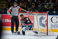 KELOWNA, CANADA - OCTOBER 26:  Referee Kevin Bennett stands at the net of Michael Herringer #30 of the Kelowna Rockets as he adjust his gear during first period against the Victoria Royals on October 26, 2016 at Prospera Place in Kelowna, British Columbia, Canada.  (Photo by Marissa Baecker/Shoot the Breeze)  *** Local Caption ***