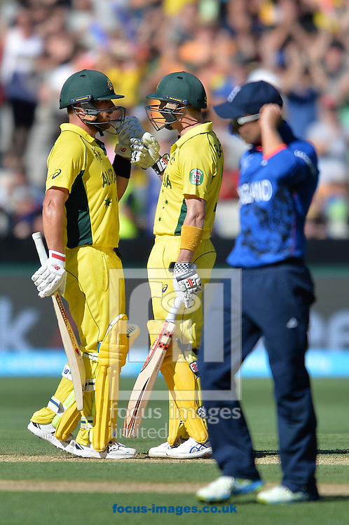 George Bailey of Australia (R) celebrates after reaching his half century with Aaron Finch of Australia (R) during the 2015 ICC Cricket World Cup match at Melbourne Cricket Ground, Melbourne<br /> Picture by Frank Khamees/Focus Images Ltd +61 431 119 134<br /> 14/02/2015