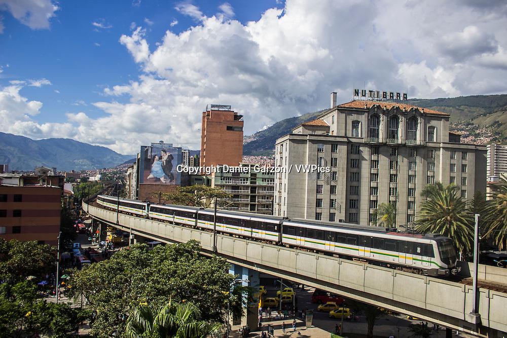 A metro train runs through downtown Medellin, Colombia