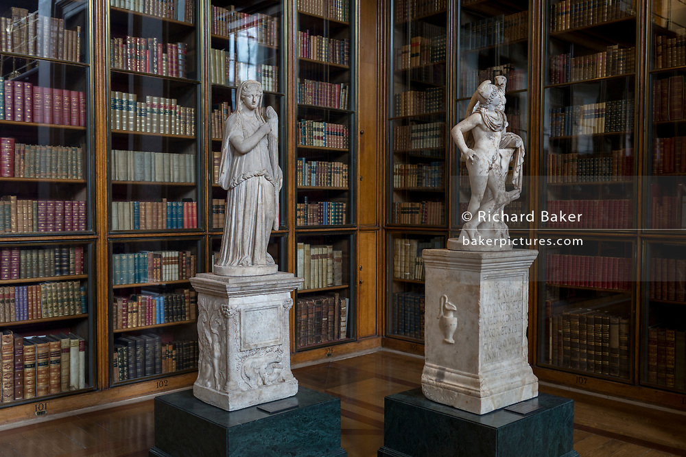 2nd century Roman copies from Greek originals of Demeter holding a torch (L) and Gannymede with the eagle of Zeus (R), in the Enlightenment Gallery of the British Museum, on 11th April 2018, in London, England.