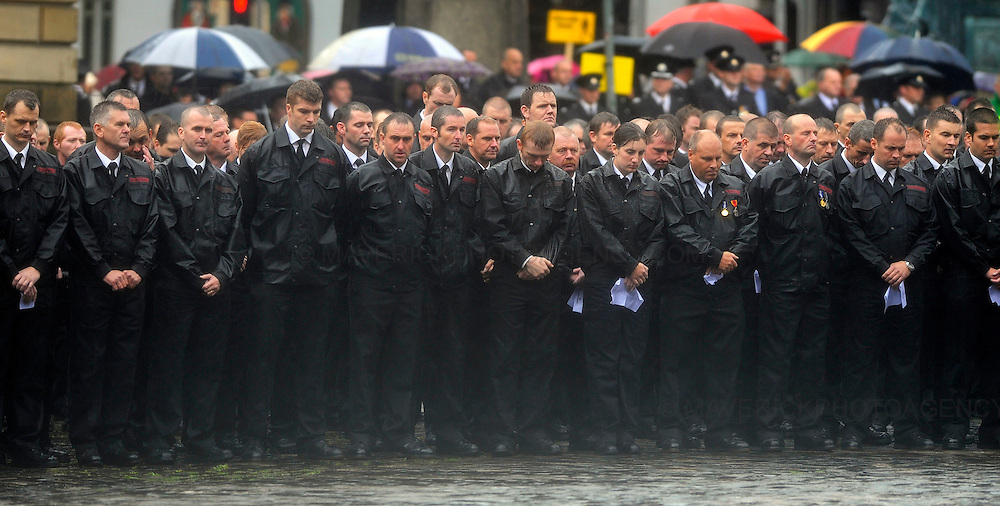 The funeral of Lothian and Borders fire fighter Ewan Williamson was held today in a private service at Edinburgh's St Giles Cathedral. The fire fighter was killed helping rescue people during a fire at the Balmoral Bar in Dalry Road, Edinburgh on 12th July 2009.  Pictured fire fighters mourn outside St Giles Cathedral during the funeral.