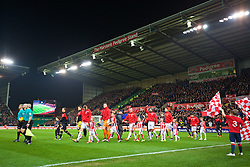 STOKE-ON-TRENT, ENGLAND - Tuesday, January 5, 2016: Stoke City and Liverpool players walk out to before the Football League Cup Semi-Final 1st Leg match at the Britannia Stadium. (Pic by David Rawcliffe/Propaganda)