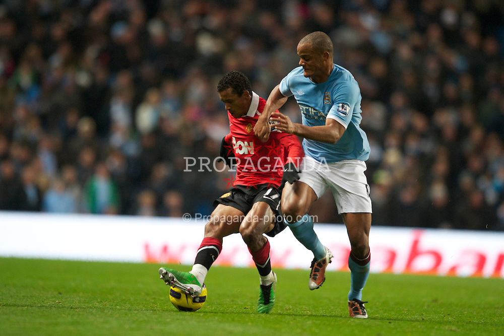 MANCHESTER, ENGLAND - Wednesday, November 10, 2010: Manchester City's Vincent Kompany and Manchester United's Nani during the Premiership match at the City of Manchester Stadium. (Pic by: Chris Brunskill/Propaganda)