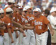 Texas head coach Augie Garrido (16) goes down the line shaking hands with Longhorn players before their game with Florida.  Texas defeated Florida 4-2 in game one of the Championship Series of the College World Series at Rosenblatt Stadium in Omaha, Nebraska on June 25, 2005.