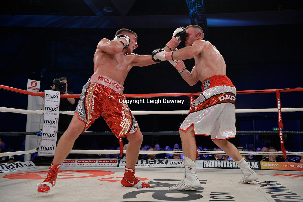 Nick Blackwell (left) defeats Nathan King in a middleweight boxing contest at Glow, Bluewater, Kent on the 8th November 2014. Promoter: Hennessy Sports. © Leigh Dawney Photography 2014.