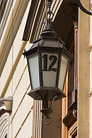 Detail of a lamp and house number in the Stare Miasto Old Town in Krakow Poland