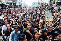 People crowd onto closed roads and sidewalks outside of Siriraj Hospital to await the funeral procession of King Bhumibol on June 14, 2016 in Bangkok, Thailand. Thailand's King Bhumibol Adulyadej, the world's longest-reigning monarch, died at the age of 88 in Bangkok's Siriraj Hospital on Thursday after his 70-year reign. Prime Minister Prayut Chan-ocha made a statement Thailand would hold a one-year mourning period as the Crown Prince Maha Vajiralongkorn confirmed that he would perform his duty as heir to the throne.