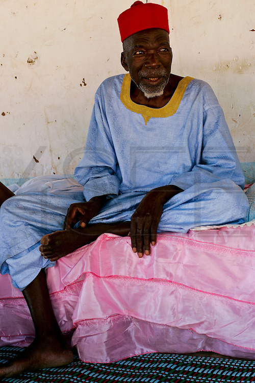 "The holy man in Bafata-Oio village, Aladji Fode Mai Toure. Locally known as ""Homem Grande"", meaning 'great man', serving as a community and local leader. Half of the population are considered to be muslim."