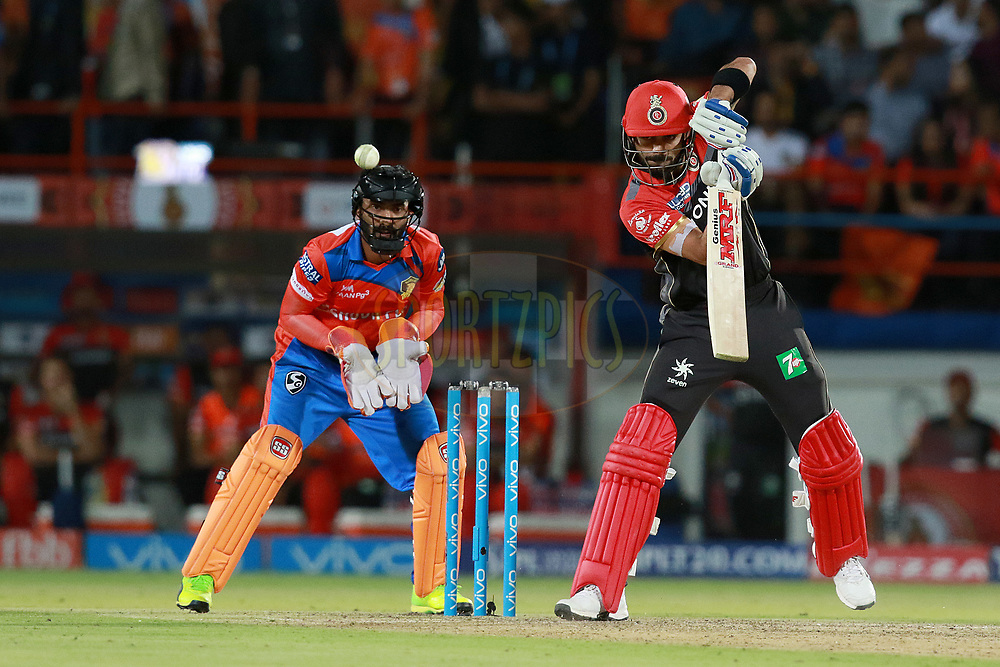 Virat Kohli  captain of RCB plays a shot during match 20 of the Vivo 2017 Indian Premier League between the Gujarat Lions and the Royal Challengers Bangalore  held at the Saurashtra Cricket Association Stadium in Rajkot, India on the 18th April 2017<br /> <br /> Photo by Rahul Gulati - Sportzpics - IPL