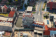 Nederland, Noord-Holland, Zaanstad, 14-06-2012; Inverdan, nieuwe stadscentrum Zaandam, masterplan Sjoerd Soeters. Het Zaanse huisjeshotel - Inntel Hotel - is een ontwerp Wilfried van Winden..New  center of the city of Zaandam, developed according to the master plan by architect Sjoerd Soeters. Train station in the foreground. The hotel built in a postmodern version of the style of the historic houses of Zaandam- Inntel Hotel - was designed by Wilfried van Winden..luchtfoto (toeslag), aerial photo (additional fee required).foto/photo Siebe Swart