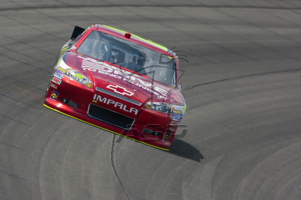 KANSAS CITY, KS - APR 20, 2012:  Jeff Gordon (24) brings his car through the turns during a practice session for the STP 400 at the Kansas Speedway in Kansas City, KS.