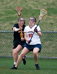 Virginia Cavaliers A Kate Breslin (20) protects the ball from Princeton Tigers M Christine Dobrosky (2).  The Virginia Cavaliers women's lacrosse team defeated the Princeton Tigers 9-7 at Klockner Stadium in Charlottesville, VA on March 24, 2007.