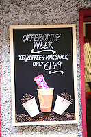 Tea and coffee take-away special offer sign outside shop in Dublin Ireland