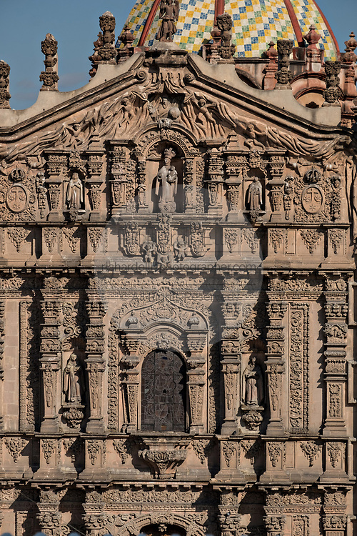 The Baroque Churrigueresque style Josephine entryway on the Iglesia del Carmen church and convent in the historic center on the Plaza del Carmen in the state capital of San Luis Potosi, Mexico.