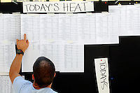 Steve Williamson, of Leeds, England, checks the heat sheets during the U.S. Paralympics Track and Field National Championships at Lakewood Stadium in Atlanta on Saturday, July 1, 2006. Williamson, on his first visit to the U.S., will compete in the Peachtree Road Race on Tuesday. The Paralympics event is the qualifier to gain entry on the U.S. Team for the International Paralympic Committee Athletics Championships in Switzerland.