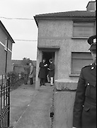 "John O'Grady Rescued By Gardai.   (R67)..1987..05.11.1987..11.05.1987..5th November 1987..After being kidnapped from his home in Cabinteely, Co Dublin, John O'Grady was finally rescued after twenty one days in captivity. he was located in a house inCarnlough Road, Cabra West, Dublin. During his ordeal Mr O""Grady was mutilated by the kidnappers led by Dessie O'Hare to apply pressure on his family to pay the ransom sought. In an ensuing gun battle with the kidnappers a detective garda was shot and seriously wounded. In the chaos that followed the kidnappers escaped and were not all captured for a further three weeks after a massive manhunt...Image shows the house in Carnlough Road, Cabra where John O'Grady was held by the kidnappers."