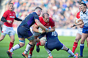 Alun Wyn Jones (Capt) (#5) of Wales is stopped by Magnus Bradbury (#6) of Scotland and Finn Russell (#10) of Scotland during the Guinness Six Nations match between Scotland and Wales at BT Murrayfield Stadium, Edinburgh, Scotland on 9 March 2019.