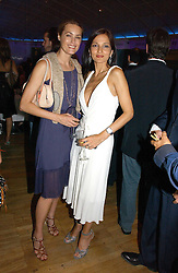 Left to right, YASMIN LE BON and YASMIN MILLS at a party to celebrate the publication of 'How to Party' by Yasmin Mills with illustrations by Olympia Scarry, held at the Fifth Floor Restaurant, Harvey Nichols, Knightsbridge, London on 3rd July 2006.<br /><br />NON EXCLUSIVE - WORLD RIGHTS