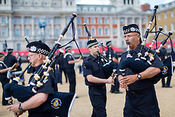 © London News Pictures. 10/06/2014. London, UK. The Vancouver Police Pipe Band rehearse for the ceremonial 'Beating Retreat' event on Horse Guards Parade in London. The event, which is part of the celebration marking the Royal Marines' 350th anniversary, takes place on the year that marks the 100th anniversary of the start of the First World War, and the 70th anniversary of the Battle for D-Day. Also taking part in this years event are will be the Bands of the Troupes de Marine and the Légion étrangère, from the French Army. Photo credit : Tolga Akmen/LNP