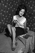 Marie Brown modelling stockings at Salon Serma.17.07.1961