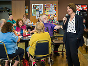 15 JULY 2019 - DES MOINES, IOWA: Senator AMY KLOBUCHAR (D-MN), right, talks talks to a group of older Iowans during lunch in a community center in Des Moines. Sen. Klobuchar hosted a roundtable on issues important to older Americans at a community center in Des Moines. Klobuchar is running to be the Democratic candidate for President in the 2020 election. Iowa hosts the first event of the Presidential election cycle. The Iowa Caucuses are on February 3, 2019.        PHOTO BY JACK KURTZ