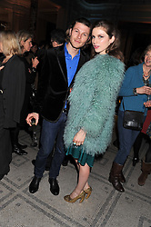 TALI LENNOX and STEPHEN BACCARI at a private view of Photographs by Cecil Beaton celebrating the diamond jubilee of HM The Queen Elizabeth 11 at the Victoria & Albert Museum, Cromwell Road, London on 6th February 2012.