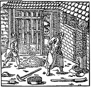 Stamping and roasting ore to extract metal (lead copper, silver and gold treated in this way).  Mill powered by water wheel and individual stamps operated by cams on drive shaft From Agricola 'De re metallica', Basle, 1556. Woodcut