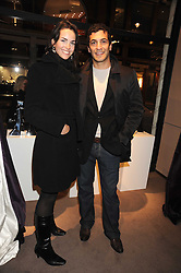 OCTAVIA KHASHOGGI and actor SIMON KASSIANIDES at a party to celebrate the launch of the Raffles Asprey Cocktail, held at Asprey, New Bond Street, London on 13th November 2008.