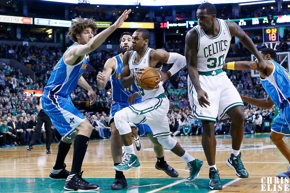 16 January 2013: Boston Celtics point guard Rajon Rondo (9) drives past New Orleans Hornets point guard Greivis Vasquez (21) and New Orleans Hornets center Robin Lopez (15) during the New Orleans Hornets 90-78 victory over the Boston Celtics at the TD Garden, Boston, Massachusetts, USA.