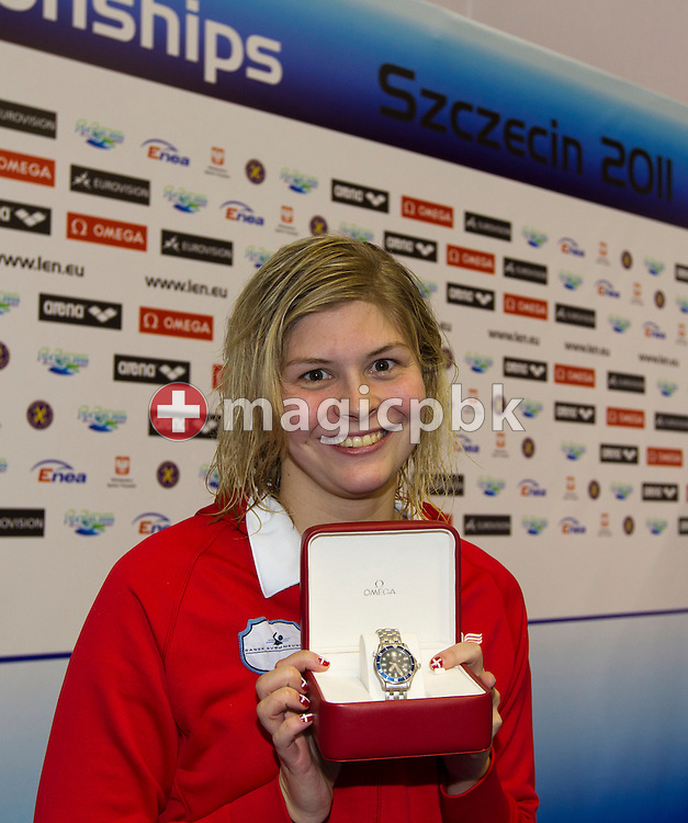 Lotte FRIIS of Denmark poses with an Omega watch for the best performance of the day during the 15th European Short Course Swimming Championships in Szczecin, Poland, Saturday, Dec. 10, 2011. (Photo by Patrick B. Kraemer / MAGICPBK)