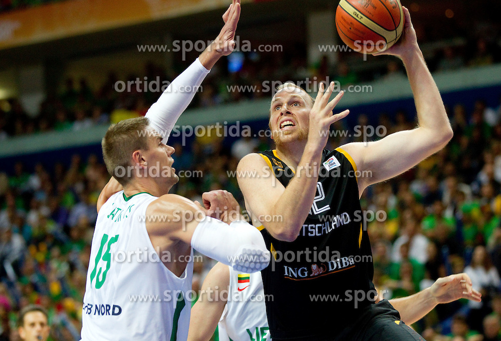 Robertas Javtokas of Lithuania vs Chris Kaman of Germany during basketball game between National basketball teams of Lithuania and Germany at FIBA Europe Eurobasket Lithuania 2011, on September 11, 2011, in Siemens Arena,  Vilnius, Lithuania. (Photo by Vid Ponikvar / Sportida)
