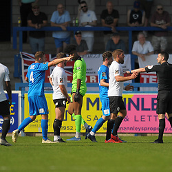 TELFORD COPYRIGHT MIKE SHERIDAN Shane Sutton of Telford leads the protests after a penalty is given by referee Scott Simpson in the first half - he changed his mind and awarded a free kick after speaking to his linesman during the National League North fixture between AFC Telford United and Leamington AFC at the New Bucks Head on Monday, August 26, 2019<br /> <br /> Picture credit: Mike Sheridan<br /> <br /> MS201920-005