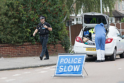 © Licensed to London News Pictures. 01/07/2017. GRAYS, Essex, UK.  A forensic officer and police officer arrives at the police cordon at Blackshots Lane in Grays, Essex. A man has died and three others have life threatening injuries following a street fight in Blackshots Lane, Grays, Essex last night.  Photo credit: Vickie Flores/LNP