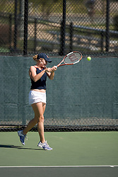 Britney Larson in action against Wake.  The Virginia Cavaliers Women's Tennis team fell to the #14 Wake Forest Demon Decons 6-1 at the Snyder Tennis Center in Charlottesville, VA on March 25, 2007.