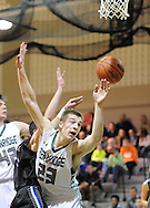 Pennridge's Kyle Yoder #23 loses control, of a rebound as Central Bucks South's Nate Robinson #1 in the first quarter Friday February 12, 2016 at Pennridge High School in Perkasie, Pennsylvania.  (Photo by William Thomas Cain)
