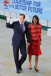 © Licensed to London News Pictures. 05/10/2011. MANCHESTER. UK. The Prime Minister, David Cameron and his wife Samantha Cameron arriving at the Conservative Party Conference in Manchester Central today, October 5, 2011. Photo credit:  Stephen Simpson/LNP