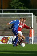14.07.2002, Pori, Finland..Veikkausliiga 2002 / Finnish League 2002..FC Jazz Pori v Tampere United..Ville Lehtinen (TreU) v Jani Raukko (FC Jazz).©Juha Tamminen
