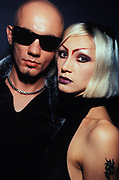 A man with sunglasses and woman with dyed hair and tattoo, Croatia, 1997.